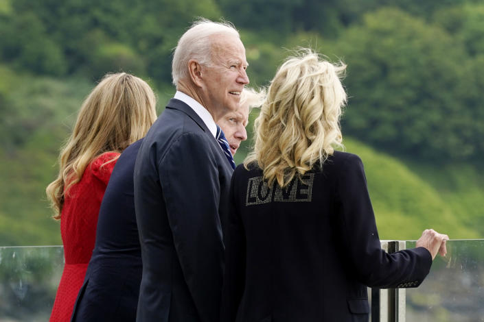 President Joe Biden and first lady Jill Biden are greeted and talk with British Prime Minister Boris Johnson and his wife Carrie Johnson, ahead of the G-7 summit, Thursday, June 10, 2021, in Carbis Bay, England. (AP Photo/Patrick Semansky)