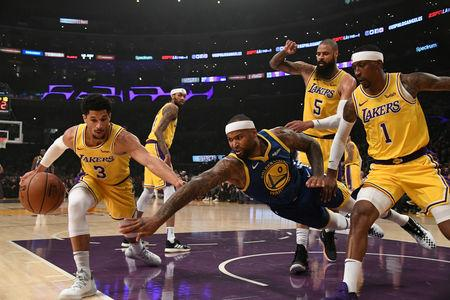 FILE PHOTO: Jan 21, 2019; Los Angeles, CA, USA; Golden State Warriors center DeMarcus Cousins (0) drives to the basket against Los Angeles Lakers guard Kentavious Caldwell-Pope (1) and Los Angeles Lakers center Tyson Chandler (5) during the first quarter at Staples Center. Mandatory Credit: Richard Mackson-USA TODAY Sports/File Photo
