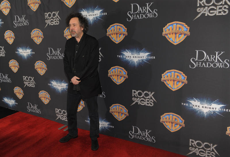 """Tim Burton, director of the upcoming film """"Dark Shadows,"""" poses backstage following Warner Bros.' presentation at CinemaCon 2012, the official convention of the National Association of Theater Owners, Tuesday, April 24, 2012, in Las Vegas. (AP Photo/Chris Pizzello)"""