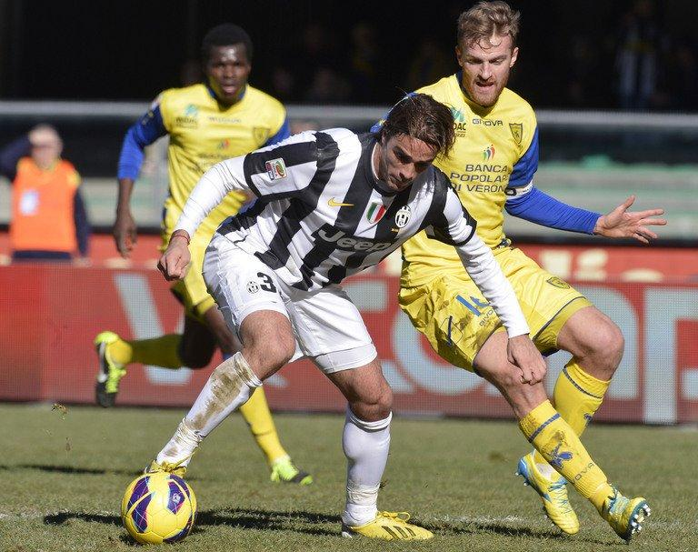 Juventus' Alessandro Matri (C) fights for the ball with Chievo's Luca Rigoni, in Verona, on February 3, 2013