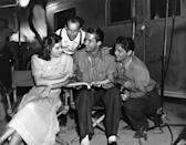 <p>The actress discusses a scene on the set of <em>Next Time I Marry</em> with the film's director, Garson Kanin, her costar, James Ellison — and Ellison's stand-in, Allan Kneip. </p>