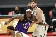 Toronto Raptors' Pascal Siakam (43) is defended by Brooklyn Nets' Joe Harris during the second half of an NBA basketball game Wednesday, April 21, 2021, in Tampa, Fla. The Raptors won 114-103. (AP Photo/Mike Carlson)