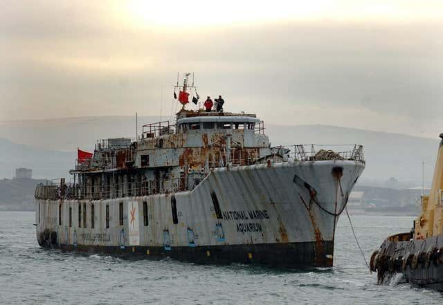 HMS Scylla is towed from Plymouth