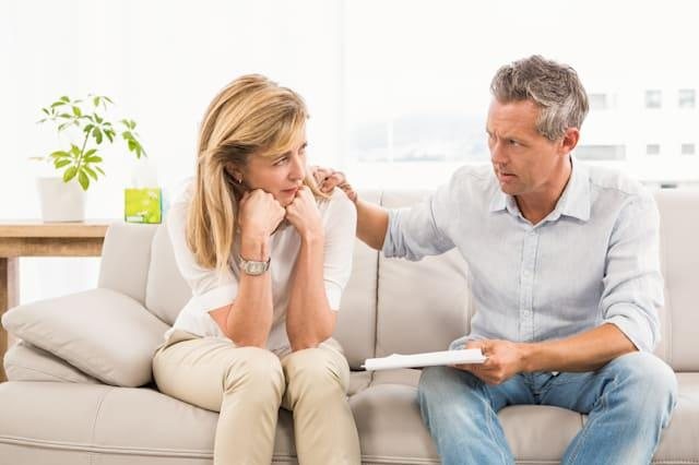 Concerned therapist comforting female patient in the office