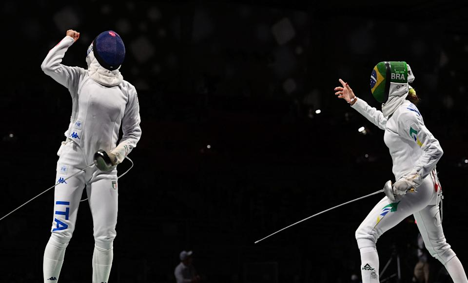 Italy's Rossella Fiamingo (L) celebrates at the end of the match against Brazil's Nathalie Moellhausen in the womens individual epee qualifying bout during the Tokyo 2020 Olympic Games at the Makuhari Messe Hall in Chiba City, Chiba Prefecture, Japan, on July 24, 2021. (Photo by Mohd RASFAN / AFP) (Photo by MOHD RASFAN/AFP via Getty Images)