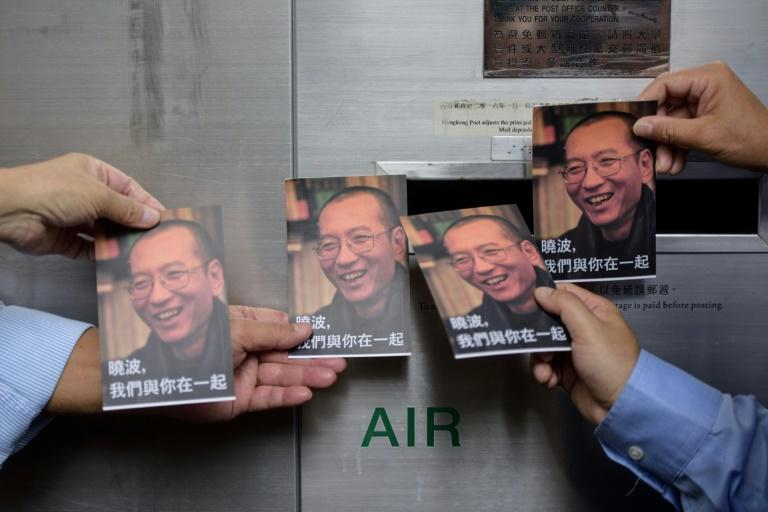 Chinese Nobel laureate Liu Xiaobo (pictured on cards) was sentenced in 2009 for 'subversion'
