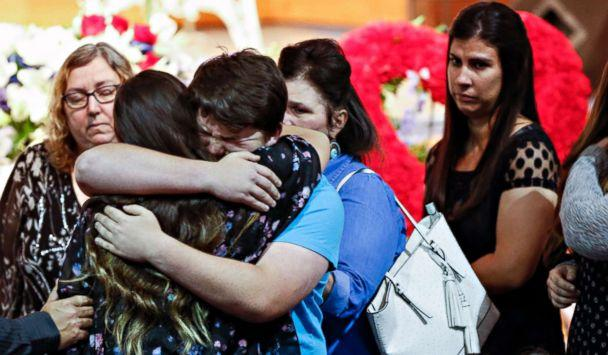Mourners embrace the family of Christian Riley Garcia during his funeral at Crosby Church on May 25, 2018, in Houston. The 15-year-old student was one of 10 people killed on May 18, 2018, during a mass shooting at Santa Fe High School. (Brett Coomer/Houston Chronicle via AP)