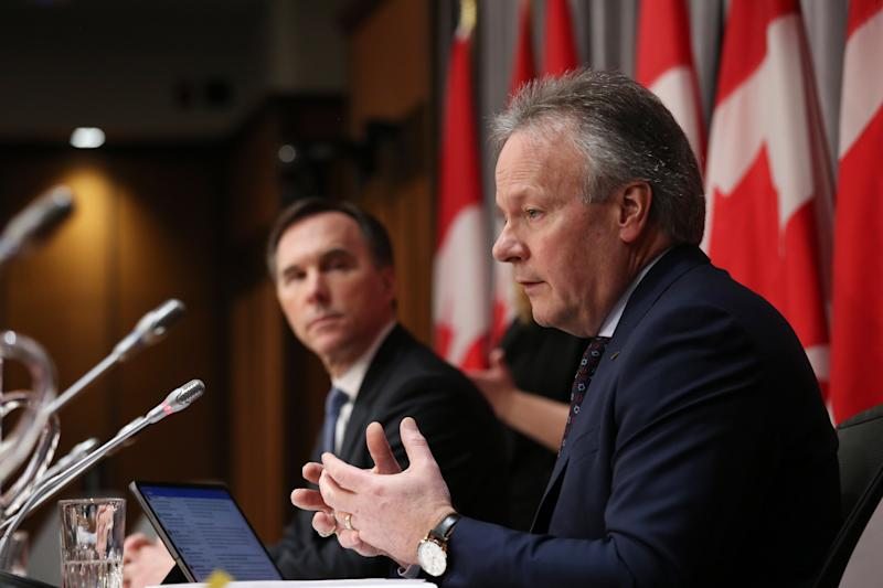 Bank of Canada Governor Stephen Poloz (R) and Finance Minister Bill Morneau (L) speaksduring a news conference on Parliament Hill March 18, 2020 in Ottawa, Ontario. - Canadian Prime Minister Justin Trudeau announced Can$27 billion in direct aid on March 18, 2020 to help workers and businesses cope with the economic impacts of the coronavirus pandemic.He said tax payments worth an estimated Can$55 billion could be deferred until August. (Photo by Dave Chan / AFP) (Photo by DAVE CHAN/AFP via Getty Images)