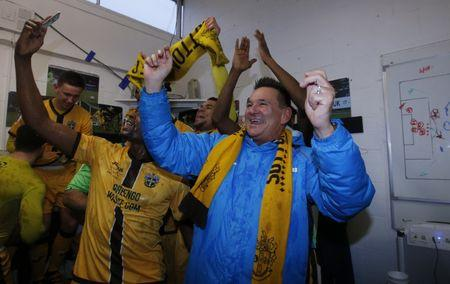 Sutton United manager Paul Doswell celebrates at the end of the match