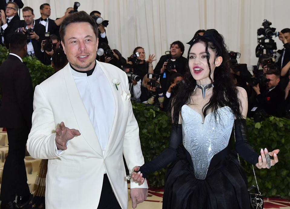 Grimes and her beau Elon Musk make their debut on the Met Gala carpet in 2018.