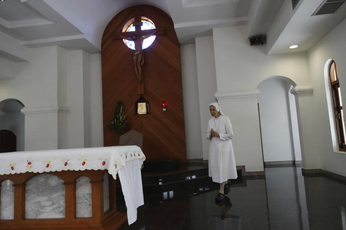 In this Aug. 27, 2019, photo, ST. Mary's School Vice Principal Sister Ana Rosa Sivori prays inside a church at the girls' school in Udon Thani, about 570 kilometers (355 miles) northeast of Bangkok, Thailand. Sister Ana Rosa Sivori, originally from Buenos Aires in Argentina, shares a great-grandfather with Jorge Mario Bergoglio, who, six years ago, became Pope Francis. So, she and the pontiff are second cousins. (AP Photo/Sakchai Lalit)
