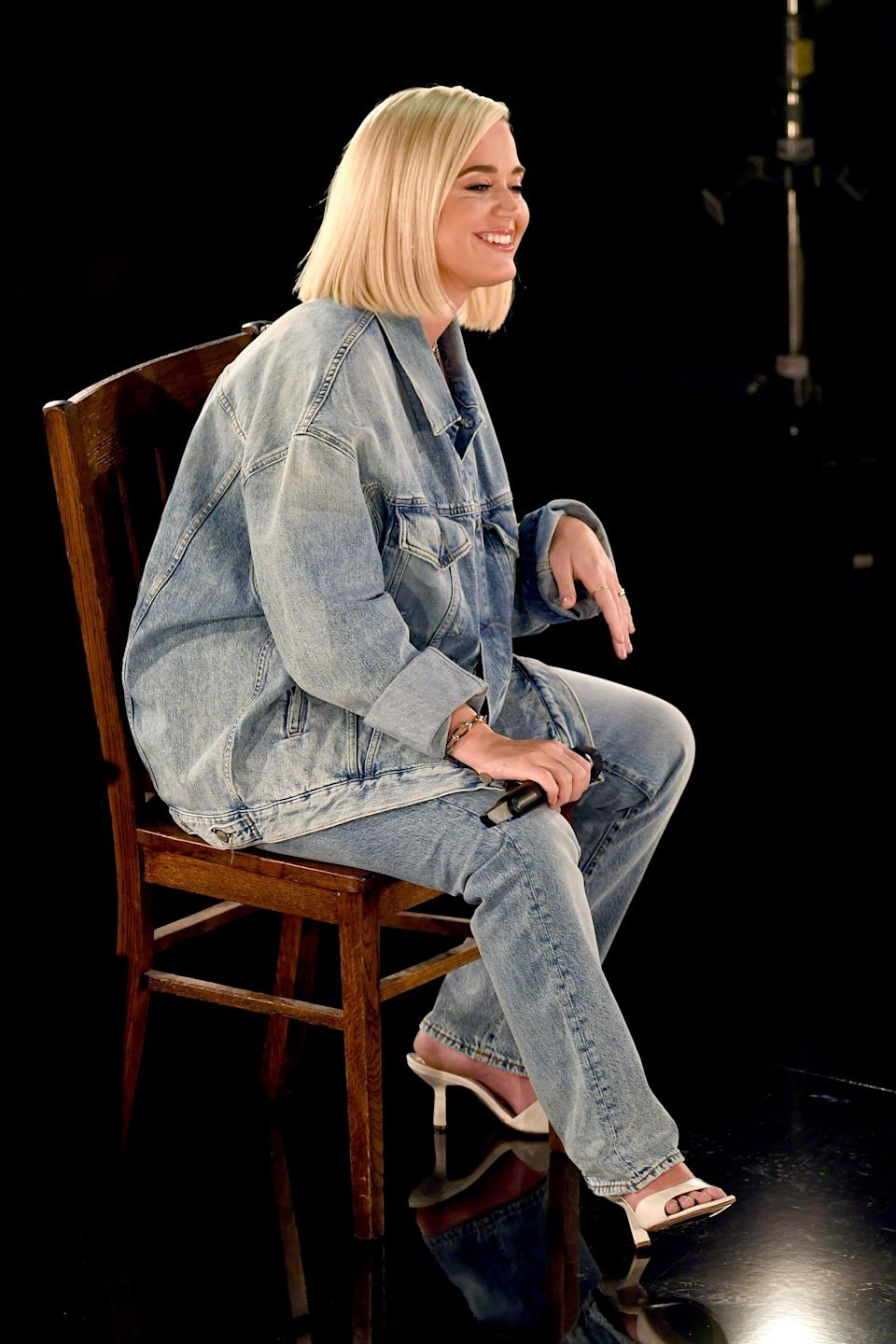 <p>Wearing Acne Studios denim with Schutz mules.</p>