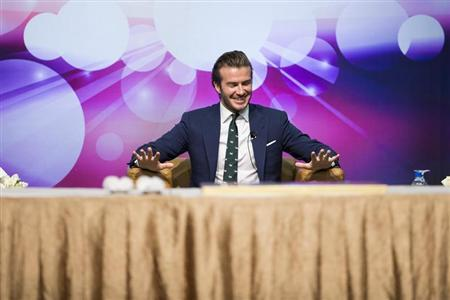 Beckham reacts during a promotional event at the Venetian Macao hotel in Macau