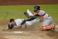 New York Yankees' Gio Urshela reacts after being tagged on the face by Baltimore Orioles catcher Pedro Severino (28) on a double play during the 11th inning of a baseball game Wednesday, April 7, 2021, at Yankee Stadium in New York. (AP Photo/Kathy Willens)