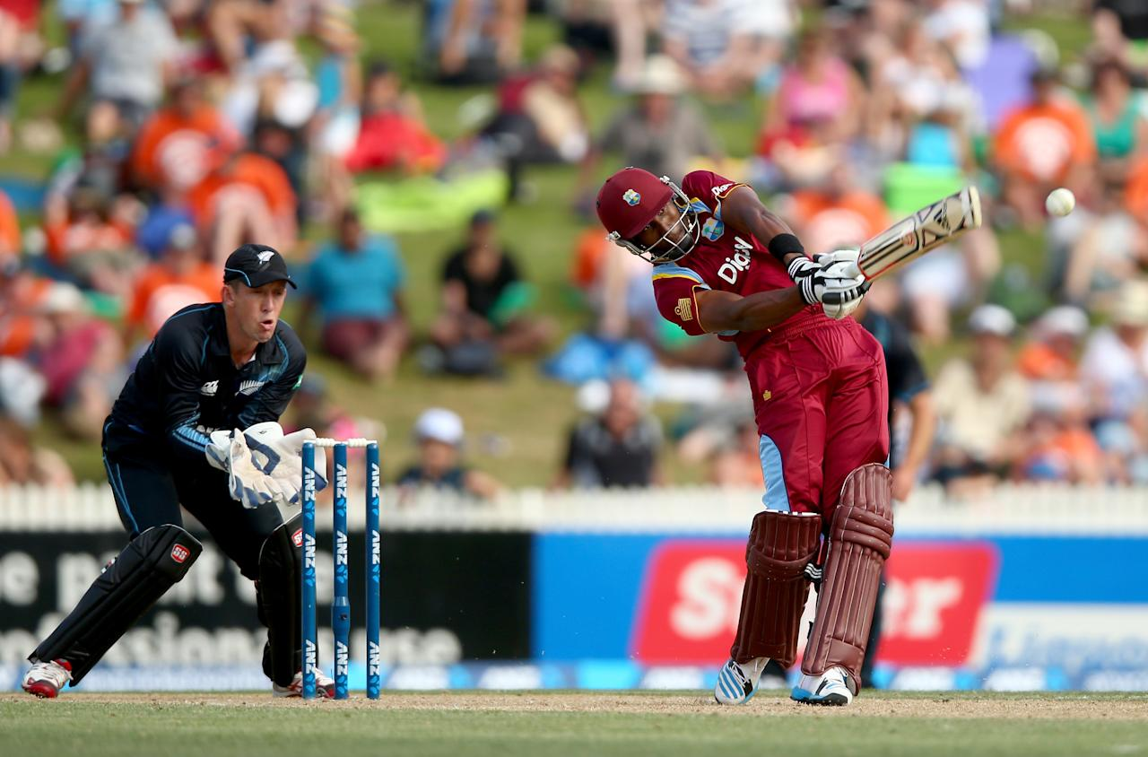 HAMILTON, NEW ZEALAND - JANUARY 08:  Dwayne Bravo of the West Indies bats during game five of the One Day International Series between New Zealand and the West Indies at Seddon Park on January 8, 2014 in Hamilton, New Zealand.  (Photo by Phil Walter/Getty Images)