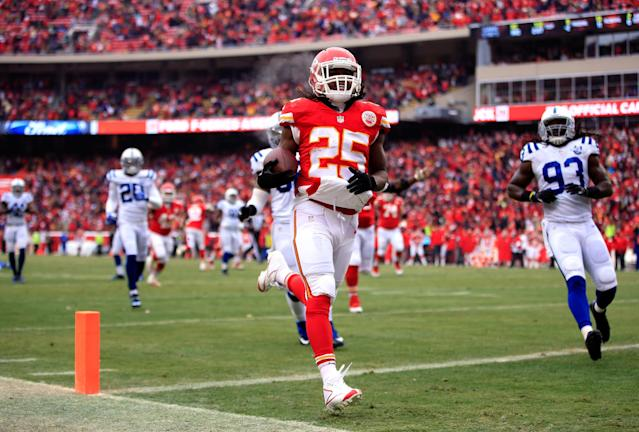 KANSAS CITY, MO - DECEMBER 22: Running back Jamaal Charles #25 of the Kansas City Chiefs carries the ball across the goal line for a touchdwon during the game against the Indianapolis Colts at Arrowhead Stadium on December 22, 2013 in Kansas City, Missouri. (Photo by Jamie Squire/Getty Images)