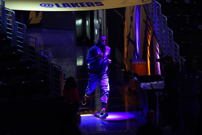 Los Angeles Lakers' LeBron James enters the court for warmups before an NBA basketball game against the Sacramento Kings, Friday, April 30, 2021, in Los Angeles. (AP Photo/Marcio Jose Sanchez)