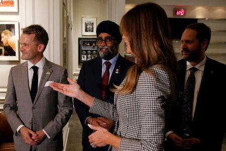 U.S. first lady Melania Trump meets dignitaries including Canada's Veterans Affairs Minister Seamus O'Regan (L) and National Defence Minister Harjit Sajjan (2nd L) as she arrives for the opening ceremony of the Invictus Games in Toronto, Canada September 23, 2017. REUTERS/Jonathan Ernst