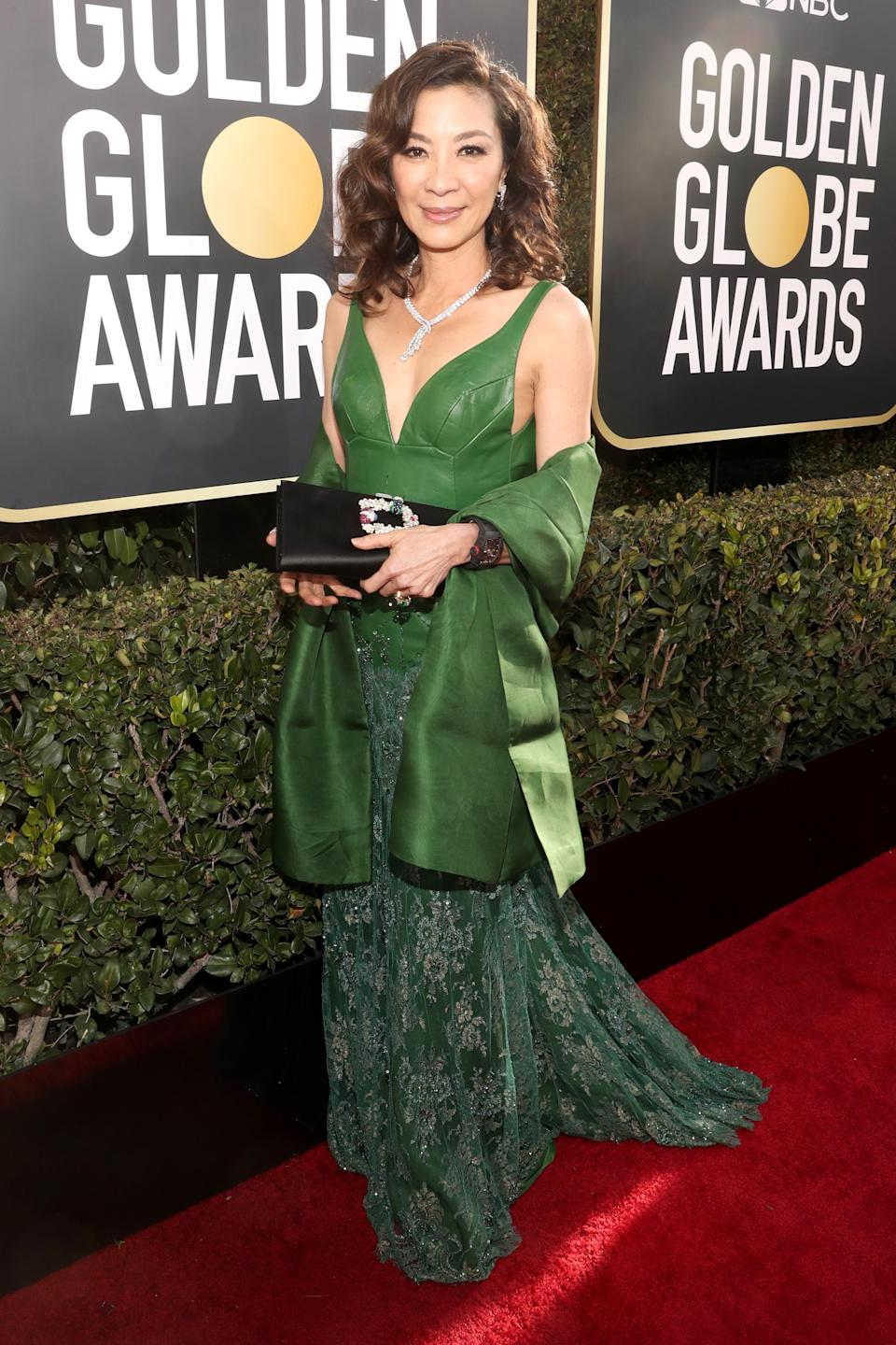 """<p>The 56-year-old star of the blockbuster """"Crazy Rich Asians"""" looked elegant in green as she arrived on the red carpet.<br>Image via Getty Images. </p>"""