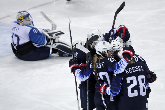 <p>Players from the United States celebrate after Dani Cameranesi (24), of the United States, scores a goal against Finland during the third period of the semifinal round of the women's hockey game at the 2018 Winter Olympics in Gangneung, South Korea, Monday, Feb. 19, 2018. (AP Photo/Julio Cortez) </p>