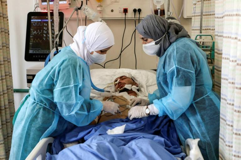 Palestinian health officials say West Bank hospitals are overwhelmed with coronavirus patients