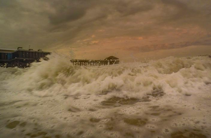 The Westgate Cocoa Beach Pier at high tide Sunday evening, Aug. 2, 2020 in Cocoa Beach, Fla.