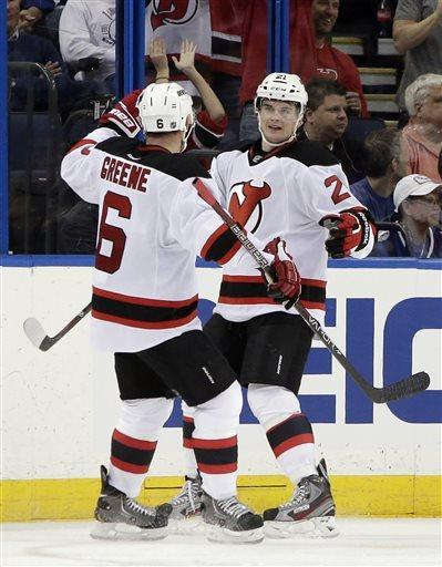 New Jersey Devils center Andrei Loktionov (21), of Russia, celebrates with teammate defenseman Andy Greene (6) after scoring against the Tampa Bay Lightning during the second period of an NHL hockey game, Friday, March 29, 2013, in Tampa, Fla. (AP Photo/Chris O'Meara)