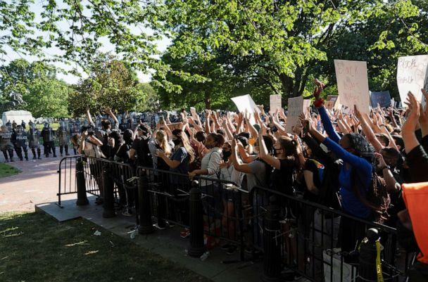 PHOTO: Protestors peacefully protest from a penned in area minutes before riot police moved to clear them out of Lafayette Park and the area around it, June 1, 2020, before President Trump appeared for a photo opportunity nearby. (Stringer/Reuters)