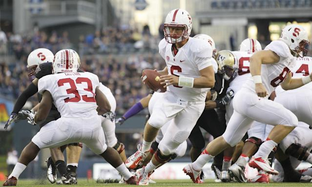 Stanford quarterback Josh Nunes, center, drops to pass against Washington in the first half of an NCAA college football game, Thursday, Sept. 27, 2012, in Seattle. Washington beat Stanford, 17-13. (AP Photo/Ted S. Warren)