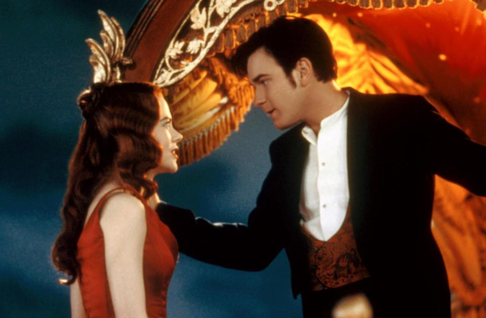 Satine and Christian singing on top of the elephant