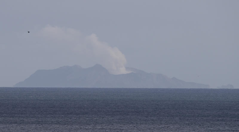 A plume of steam is seen above White Island early morning off the coast of Whakatane, New Zealand, Tuesday, Dec. 10, 2019. A volcanic island in New Zealand erupted Monday Dec. 9 in a tower of ash and steam while dozens of tourists were exploring the moon-like surface, killing at least five people and leaving many more missing. (AP Photo/Mark Baker)