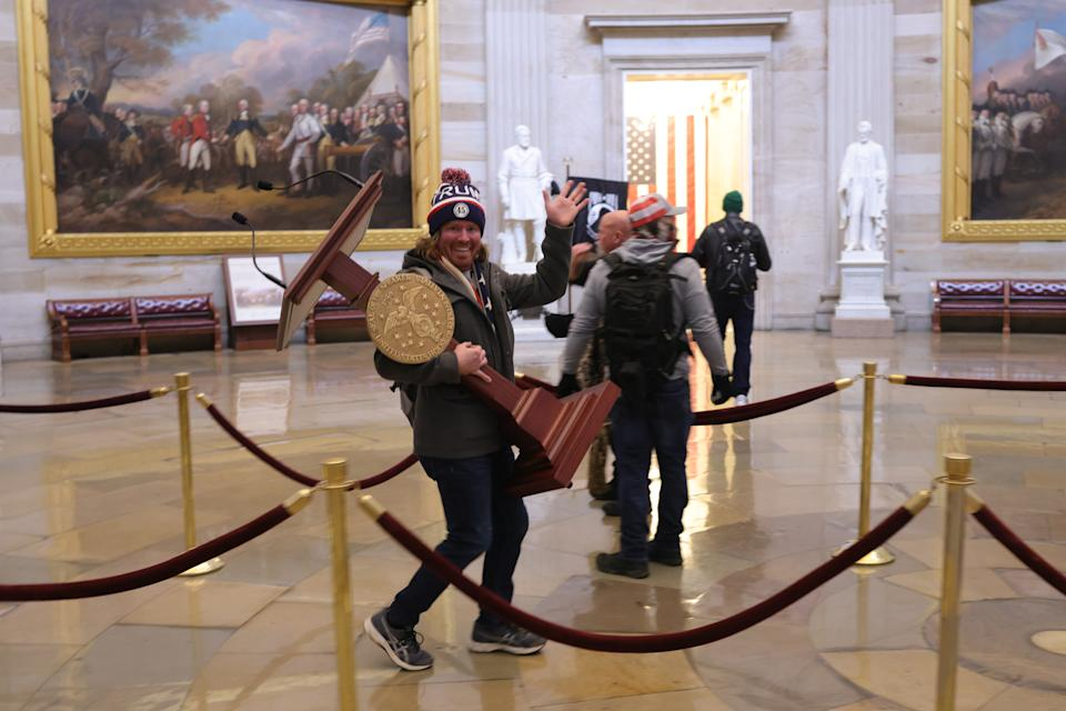 WASHINGTON, DC - JANUARY 06: Protesters enter the U.S. Capitol Building on January 06, 2021 in Washington, DC. Congress held a joint session today to ratify President-elect Joe Biden's 306-232 Electoral College win over President Donald Trump. A group of Republican senators said they would reject the Electoral College votes of several states unless Congress appointed a commission to audit the election results. (Photo by Win McNamee/Getty Images)