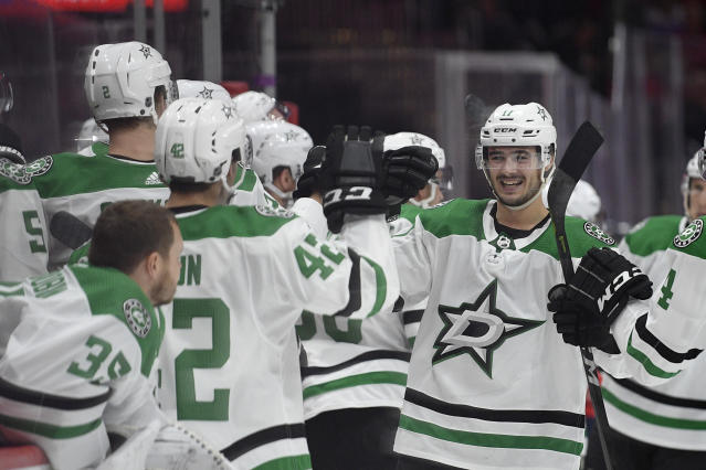 Dallas Stars right wing Nick Caamano, right, celebrates his goal during the third period of the team's NHL hockey game against the Washington Capitals, Tuesday, Oct. 8, 2019, in Washington. The Stars won 4-3 in overtime. (AP Photo/Nick Wass)