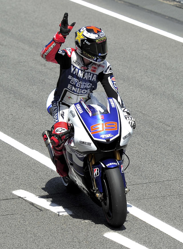 Yamaha Factory Racing's Spanish Jorge Lorenzo waves to his supporters at the Catalunya racetrack in Montmelo, near Barcelona, on June 1, 2012, during the MotoGP second training session of the Catalunya Moto GP Grand Prix. AFP PHOTO / JOSEP LAGOJOSEP LAGO/AFP/GettyImages