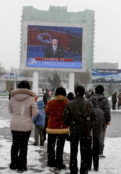 """On a large television screen in front of Pyongyang's railway station, a North Korean state television broadcaster announces the news that North Korea conducted a nuclear test on Tuesday, Feb. 12, 2013. North Korea conducted a nuclear test at an underground site in the remote northeast Tuesday, taking an important step toward its goal of building a bomb small enough to be fitted on a missile that could reach United States. The TV screen text reads: """"Korean Central News Agency reports,"""" and """"The third underground nuclear test successfully conducted."""" (AP Photo/Kim Kwang Hyon)"""