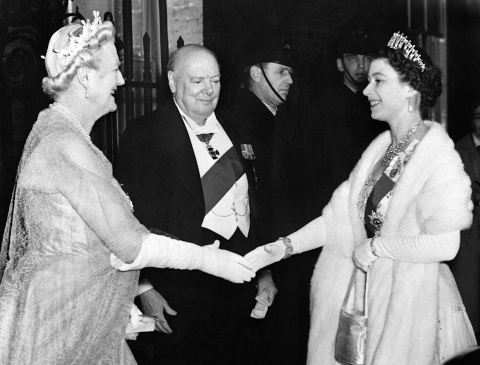 <p>Sir Winston Churchill and his wife Lady Churchill greet The Queen as she arrives for a dinner party at 10 Downing Street. (PA) </p>