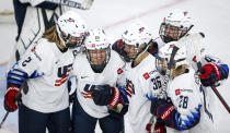 Alex Carpenter (25), of the United States, celebrates her goal against Finland with teammates during the second period of an IIHF women's hockey championships semifinal in Calgary, Alberta, Monday, Aug. 30, 2021. (Jeff McIntosh/The Canadian Press via AP)