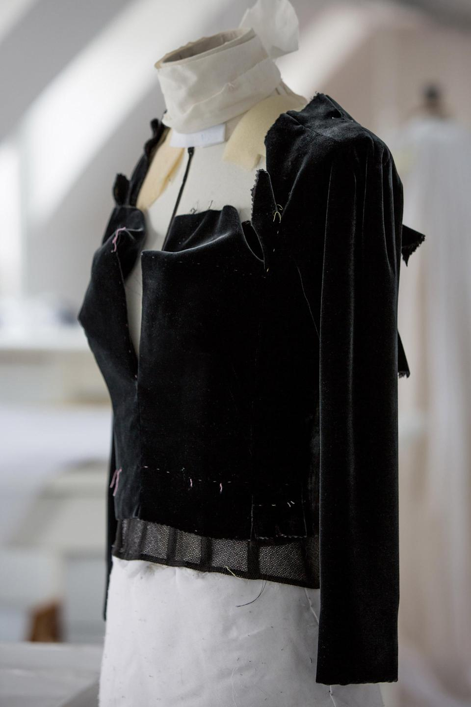<p>The velvet piece is attached on top.</p>