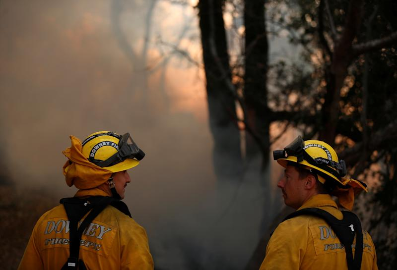 Firefighters work to control a wildfire in Sonoma County on Oct. 14, 2017. (Jim Urquhart / Reuters)