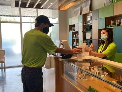 Long-time Truliever and patient Arnold Lawson makes first purchase of edibles on Tuesday, September 1, 2020, at Trulieve's Tallahassee dispensary. (CNW Group/Trulieve Cannabis Corp.)