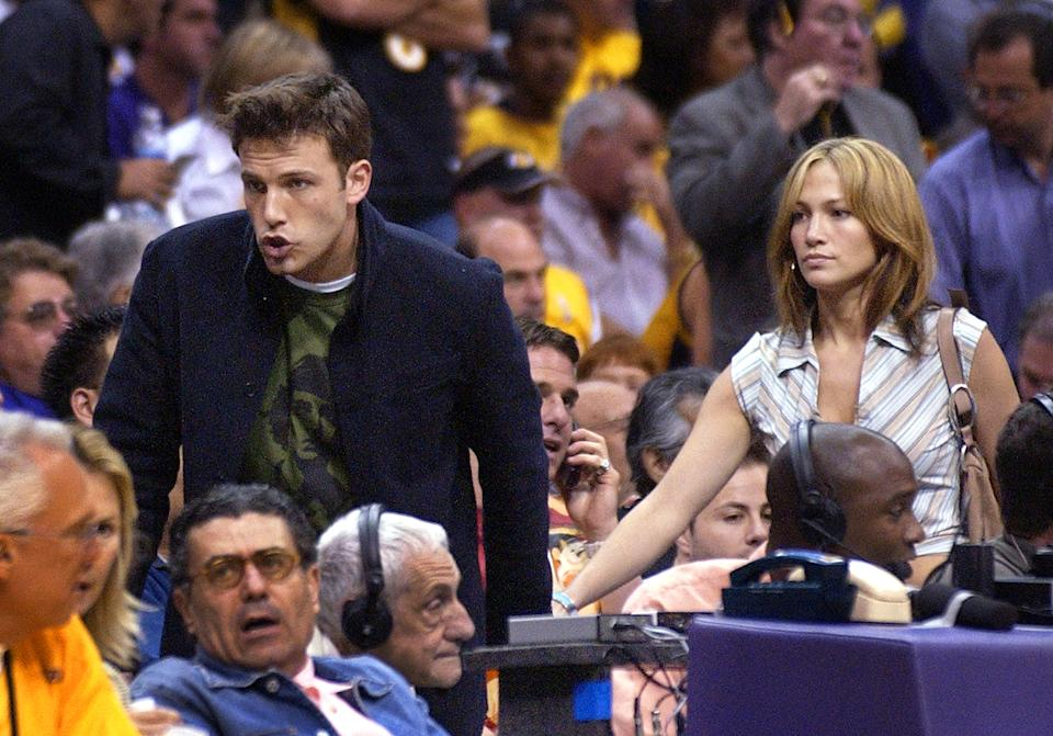 Actors Ben Affleck and Jennifer Lopez walk to their seats at the Los Angeles Lakers game against the San Antonio Spurs in the Western Conference Semifinals, Sunday, May 11, 2003, in Los Angeles. The Lakers won the game, 99-95, to tie the series at 2-2. (AP Photo/Mark J. Terrill)