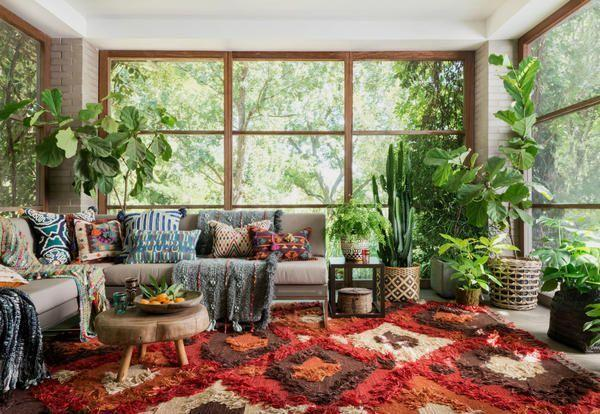 <p>If hippie vibes are your thing, take note of this 1970s-inspired living room. The colorful shag carpet, exposed brick walls, oversized plants, and assortment of patterned pillows come together for a quintessential bohemian look. </p>