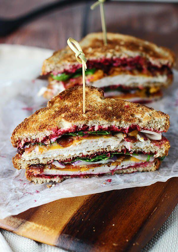 """<p>This hearty double decker sandwich is loaded with leftover turkey, leftover cranberry sauce, and <em>two</em> types of cheese. </p><p><strong>Get the recipe at <a href=""""https://ohsweetbasil.com/ultimate-leftover-turkey-club/"""" target=""""_blank"""">Oh, Sweet Basil</a>.</strong></p><p><strong><a class=""""body-btn-link"""" href=""""https://go.redirectingat.com?id=74968X1596630&url=https%3A%2F%2Fwww.walmart.com%2Fip%2FWilton-Bake-It-Better-Non-Stick-Baking-Pan-Set-3-Piece%2F44432741&sref=http%3A%2F%2Fwww.countryliving.com%2Ffood-drinks%2Fg1064%2Fthanksgiving-leftovers%2F"""" target=""""_blank"""">SHOP BAKING SHEETS</a><br></strong></p>"""