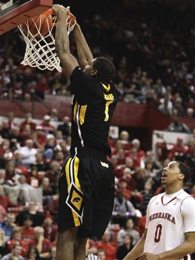 Iowa's Melsahn Basabe dunks in front of Nebraska's Toney McCray (0) in the first half of their NCAA college basketball game in Lincoln, Neb., Wednesday, Feb. 29, 2012. (AP Photo/Nati Harnik)