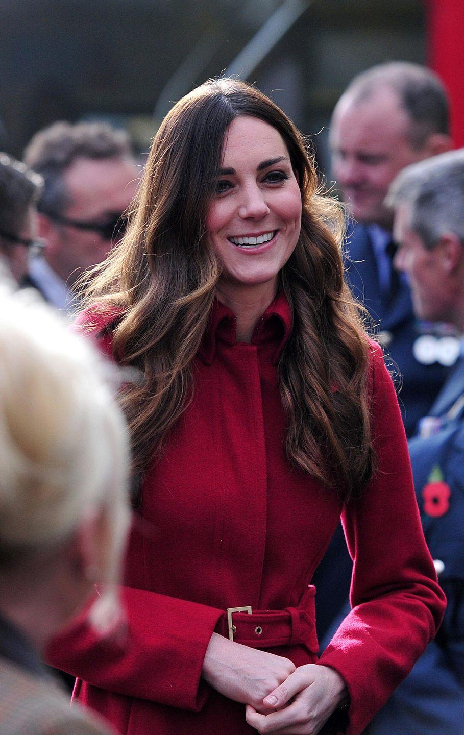<p>Kate put her hair in soft waves (possibly her first and last time wearing this hair) and buckled up her red coat for a meeting with The Royal British Legion's London Poppy Day Appeal at Kensington Palace. </p>