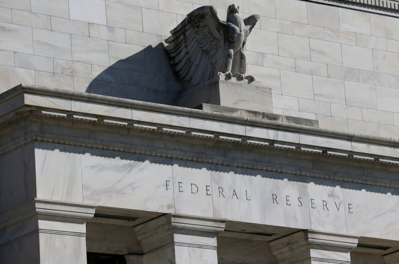 Fed touts economic recovery, vows to keep interest rates low