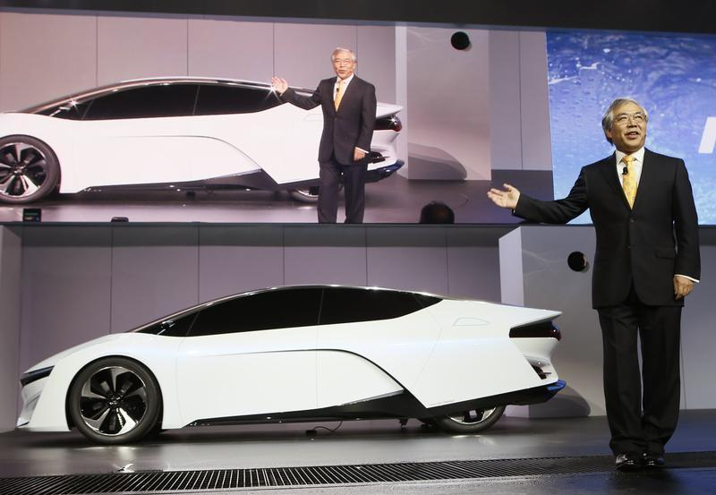 Tetsuo Iwamura, president and CEO of American Honda Motor Co. introduces the Honda FCEV Concept car during the 2013 Los Angeles Auto Show in Los Angeles