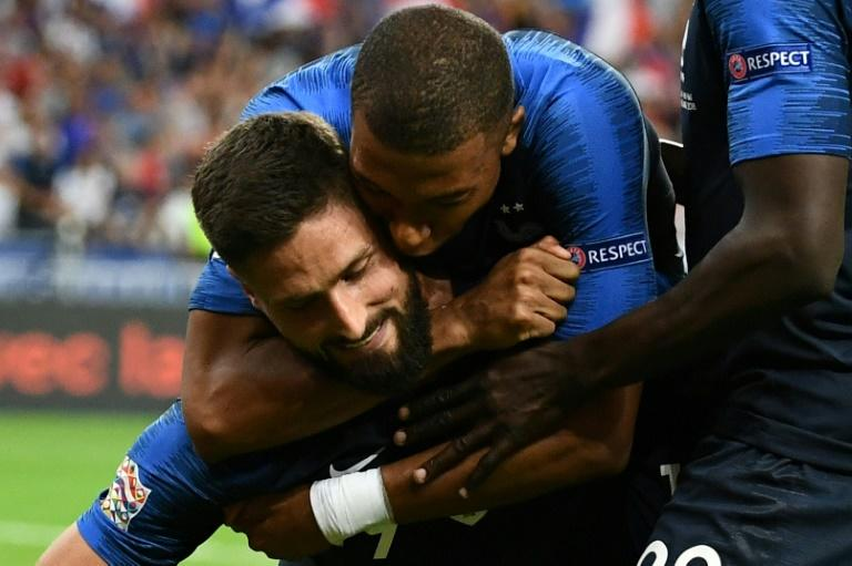 Olivier Giroud is congratulated by Kylian Mbappe after scoring France's winner