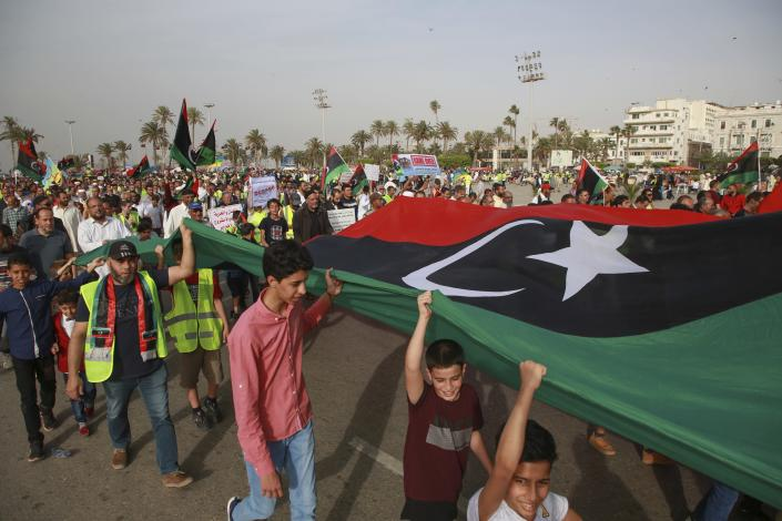 Libyans hold a demonstration at Martyrs' Square against military operations by forces loyal to Field Marshal Khalifa Hifter in Tripoli, Libya, Friday, May 3, 2019. (AP Photo/Hazem Ahmed)