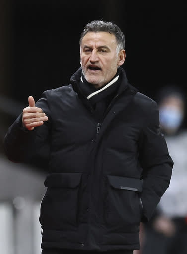 Lille's head coach Christophe Galtier gestures during a French League One Soccer match between Rennes and Lille at the Roazhon Park stadium in Rennes, France, Sunday Jan. 24, 2021. (AP Photo/David Vincent)